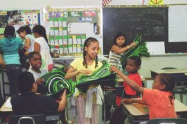 passing out reusable bags